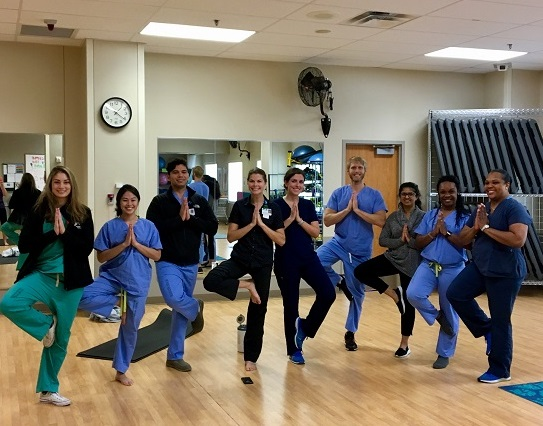 medical residents doing yoga