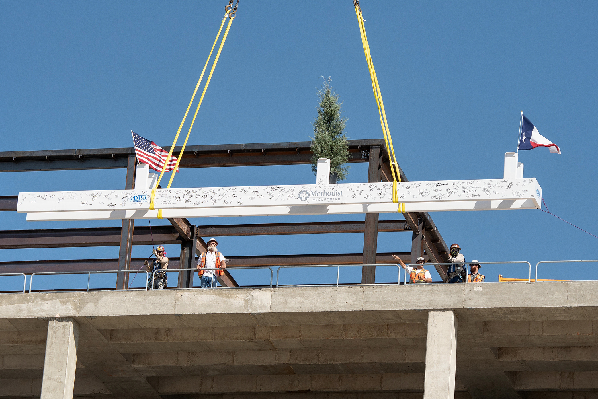 The final beam is raised to place at Methodist Midlothian
